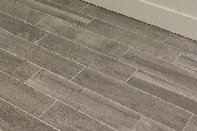 Plank tile flooring installation